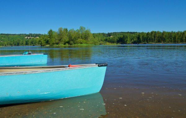 Blue canoes in Nechako River.